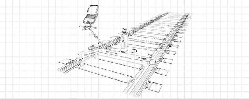 A pencil sketch on graph paper of a rail track and a trolley with measuring equipment on it.