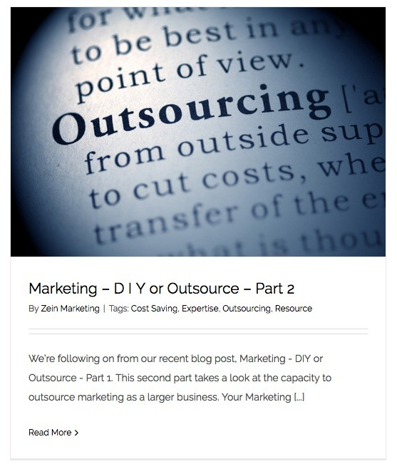 A screen shot of Zein Marketing's part of their outsourced marketing blog showing an image of a dictionary with the word Outsourcing in focus.