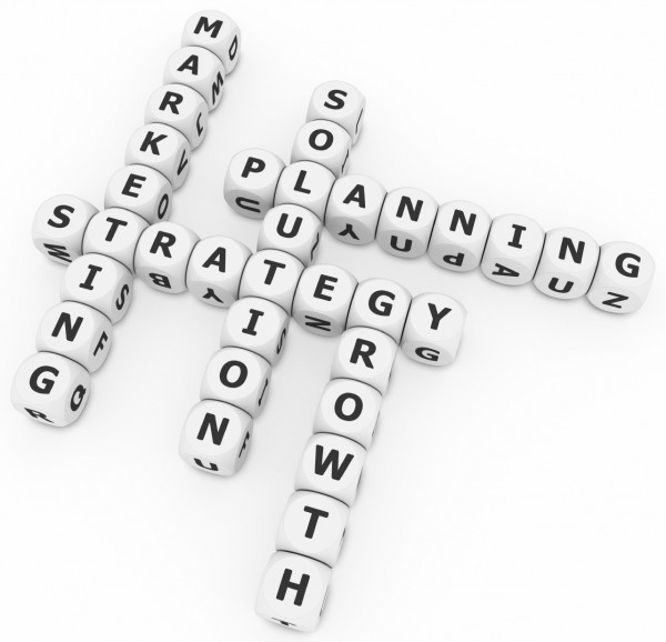An image of a puzzle viewed from above with dice making up words relating to marketing activities.