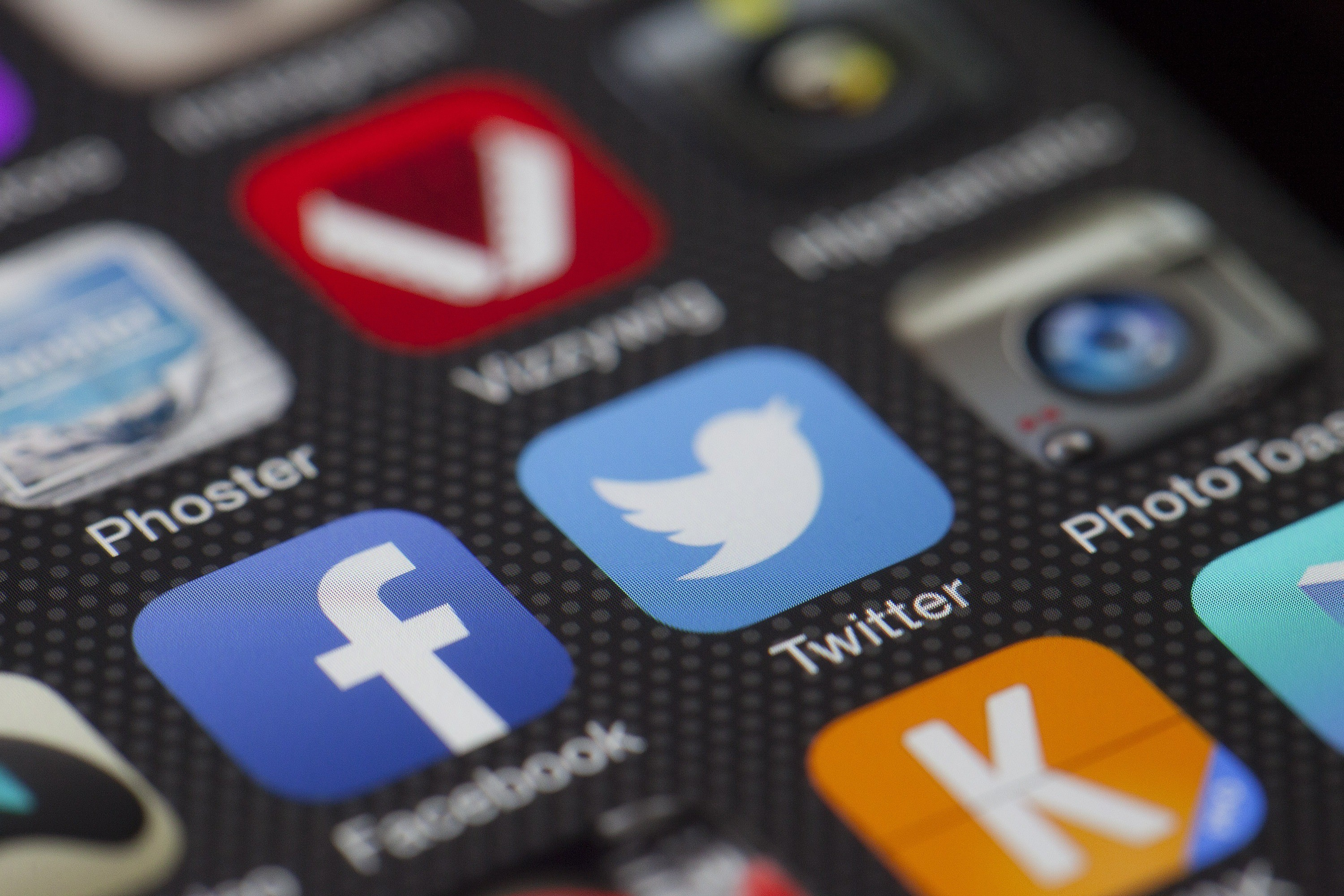 A close up image of a smart phone screen showing social media icons for Facebook, Twitter etc.