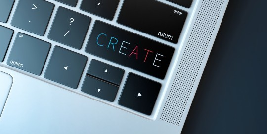 A close up image of the front right hand corner of a laptop keyboard with the word create on the shift key.