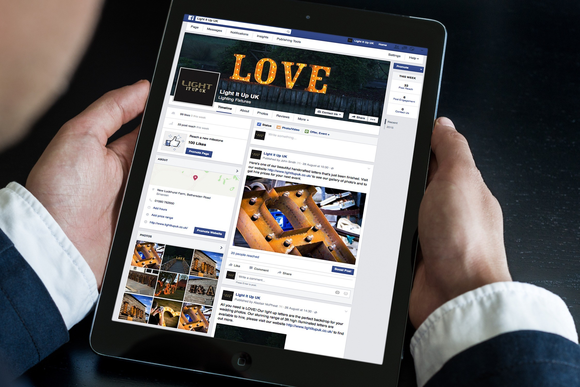 An image of someone using a tablet computer in portrait format with the Light It Up UK Twitter page on it.