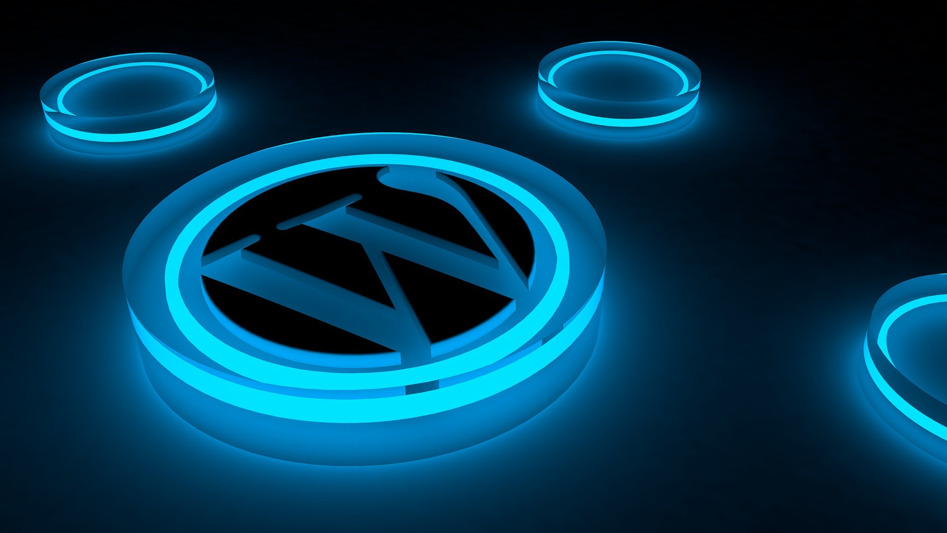 Dark blue background with 3 small an 1 large lit blue circles the large one has the WordPress logo on it.